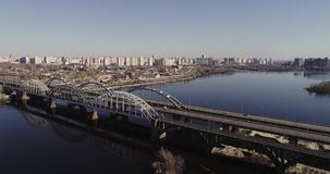 Aerial view of the city traffic on the bridge. Darnitskiy bridge, Kiev, Ukraine. Aerial view of the city, Ukraine. Dnieper river with bridges. Darnitskiy bridge stock video
