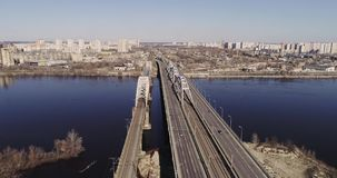 Aerial view of the city traffic on the bridge. Darnitskiy bridge, Kiev, Ukraine. Aerial view of the city, Ukraine. Dnieper river with bridges. Darnitskiy bridge stock video footage