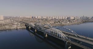 Aerial view of the city traffic on the bridge. Darnitskiy bridge, Kiev, Ukraine. Aerial view of the city, Ukraine. Dnieper river with bridges. Darnitskiy bridge stock footage