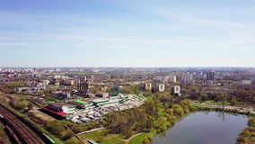 Aerial view of the city. View from the height. Filming with the drone. Minsk. Railway, factory, lake. 4K stock video