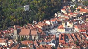 Aerial view cityscape of Brasov in Transylvania, Romania. UHD 4K stock video footage