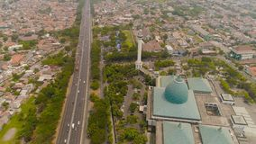 Mosque Al Akbar in Surabaya Indonesia. Aerial view cityscape city Surabaya with mosque Al Akbar, highway, buildings and houses. mosque in Indonesia Al Akbar in royalty free stock photography