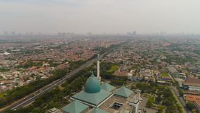 Mosque Al Akbar in Surabaya Indonesia. Aerial view cityscape city Surabaya with mosque Al Akbar, highway, skyscrapers, buildings and houses. mosque in Indonesia royalty free stock photo