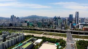 Seoul downtown city skyline with river and mountain on the background.