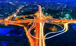 Aerial view of cityscape and traffic on highway at night Stock Images