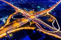 Aerial view of cityscape and traffic on highway at night Stock Photo