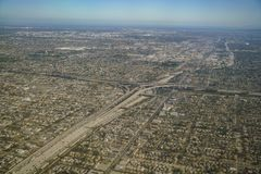 Aerial view of cityscape, view from window seat in an airplane Stock Photo