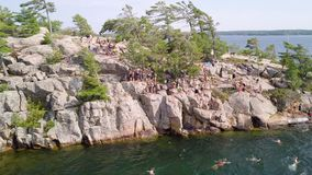 Cliff jumping, Killbear provincial park stock footage