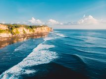 Aerial view of cliff, rocks and ocean in Bali Royalty Free Stock Images
