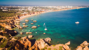 Aerial view of cliffs and beach Praia in Portimao, Algarve region, Portugal. A view of a Praia in Portimao, Algarve region, Portugal royalty free stock photography