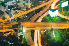 Aerial view close up, Highway intersection night view long exposure. Cityscape downtown background Stock Photos