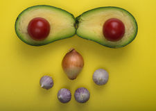Aerial view closeup guacamole dip ingredients on yellow cutting board Royalty Free Stock Photography
