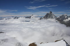 Aerial View of Cloud covered mountain ranges in Zermatt Stock Photo