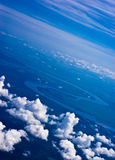 Aerial view of clouds. Over river zigzag Royalty Free Stock Images