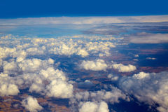 Aerial view of clouds and blue sky while flying Stock Photography