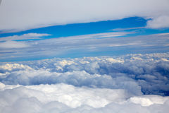 Aerial view of clouds and blue sky while flying Royalty Free Stock Photo