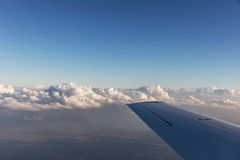 Aerial view of clouds lit by the evening sun over Florida, view from the aircraft during the flight. Royalty Free Stock Photos