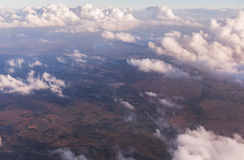 Aerial view of clouds lit by the evening sun over Florida, view from the aircraft during the flight. Stock Images