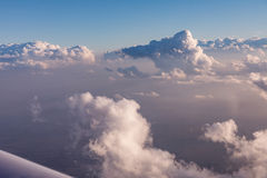 Aerial view of clouds lit by the evening sun over Florida, view from the aircraft during the flight. Stock Photos