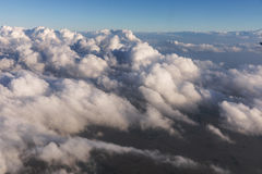 Aerial view of clouds lit by the evening sun over Florida, view from the aircraft during the flight. Stock Photo