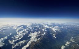 Aerial view of clouds over the earth. An unusual aerial view of clouds over the earth royalty free stock images