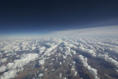 Aerial view of clouds over the earth. Royalty Free Stock Image