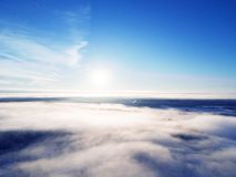 Aerial view clouds over forest during winter colors. Aerial view of forest and clouds. Coastline. Aerial drone view of the forest. Aerial top view cloudscape royalty free stock photo