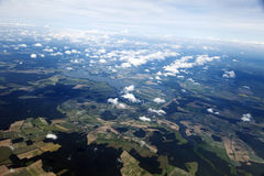 Aerial View of Clouds & Land. Aerial view of clouds over green land features Royalty Free Stock Images