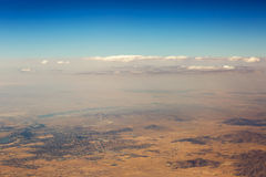 Aerial view of clouds over the land, the landscape. Royalty Free Stock Image