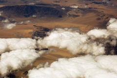 Aerial view of clouds over the land, the landscape. Royalty Free Stock Photography