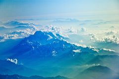 Aerial view of clouds over mountains
