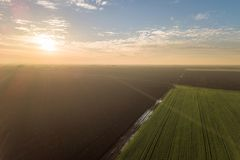 Aerial view Clouds over over green agricultural fields. Aerial view Stock Images