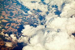 Aerial view of cloudscape and earth with fields Royalty Free Stock Photography