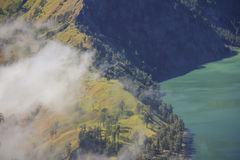 Aerial view cloudy forest at Mountain Rinjani of Indonesia. Aerial view cloudy forest at Mountain Rinjani, active volcano at Lombok island of Indonesia Royalty Free Stock Image