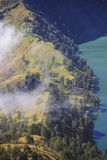 Aerial view cloudy forest at Mountain Rinjani of Indonesia. Aerial view cloudy forest at Mountain Rinjani, active volcano at Lombok island of Indonesia Royalty Free Stock Photo