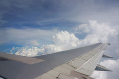 Aerial view. Of cloudy sky from aircraft windows Stock Photos