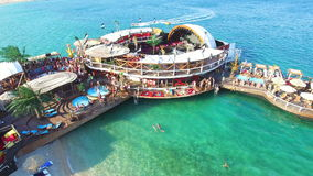 Aerial view of club stage on sea water, zrce beach on island of Pag stock footage