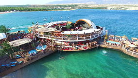 Aerial view of club stage on sea water, zrce beach on island of Pag stock video