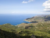 Aerial view of the coast of Corsica, winding roads and coves with crystalline sea. Cap Corse Peninsula, Corsica. Coastline. Anse d`Aliso. Gulf of Aliso. France Royalty Free Stock Images