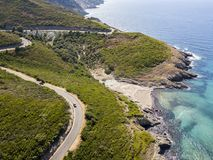 Aerial view of the coast of Corsica, winding roads and coves with crystalline sea. France. Aerial view of the coast of Corsica, winding roads and coves with Royalty Free Stock Photos