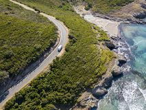 Aerial view of the coast of Corsica, winding roads and coves with crystalline sea. France. Aerial view of the coast of Corsica, winding roads and coves with Stock Image