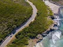 Aerial view of the coast of Corsica, winding roads and coves with crystalline sea. France. Aerial view of the coast of Corsica, winding roads and coves with Royalty Free Stock Photography