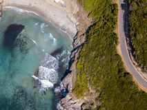Aerial view of the coast of Corsica, winding roads and coves with crystalline sea. France. Aerial view of the coast of Corsica, winding roads and coves with Stock Photography