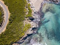 Aerial view of the coast of Corsica, winding roads and coves with crystalline sea. France. Aerial view of the coast of Corsica, winding roads and coves with Stock Images