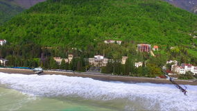 Aerial view on coast line with tide. And big waves stock video footage