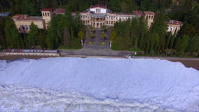 Aerial view on coast line with tide. And big waves stock footage