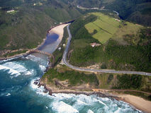 Aerial view of coastline. Aerial view of a coastline and winding road Royalty Free Stock Photography