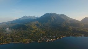 Aerial view beautiful coastline on the tropical island with volcanic sand beach. Camiguin island Philippines. Aerial view coastline on tropical island with sea stock video footage