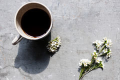 Aerial view of coffee cup with wax flowers Stock Photo