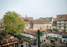 Aerial view of colmar Christmas Market in France Alsace. COLMAR, FRANCE - NOV 23, 2015: Aerial view of Colmar Alsace Christmas market with chalets market stall Stock Photos